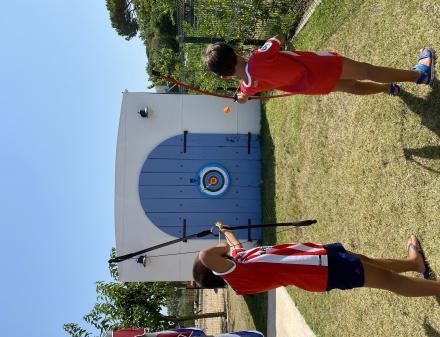 Children practicing archery