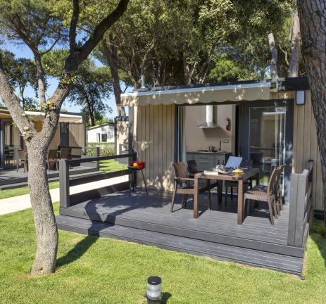 Terrassa zona jardí bungalow Camping Valldaro