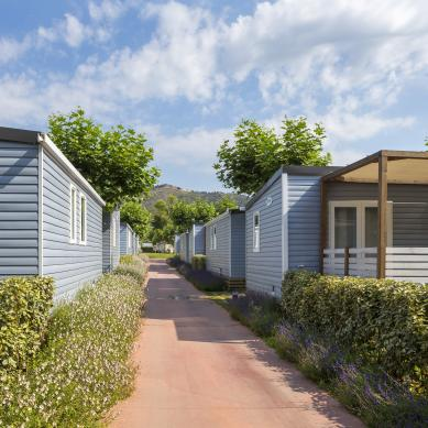 Mobile home street at Camping & Bungalows Valldaro