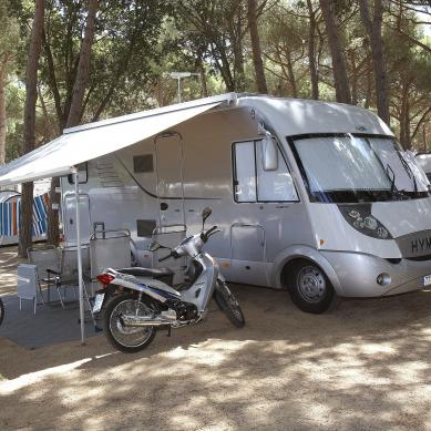 Motorhome and motorcycle at the campsite