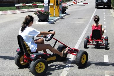 Girls driving karts